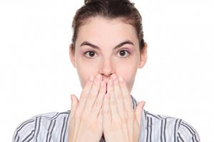Surprised Caucasian woman covering mouth